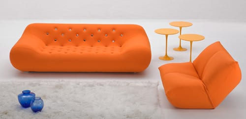 orange tufted couch