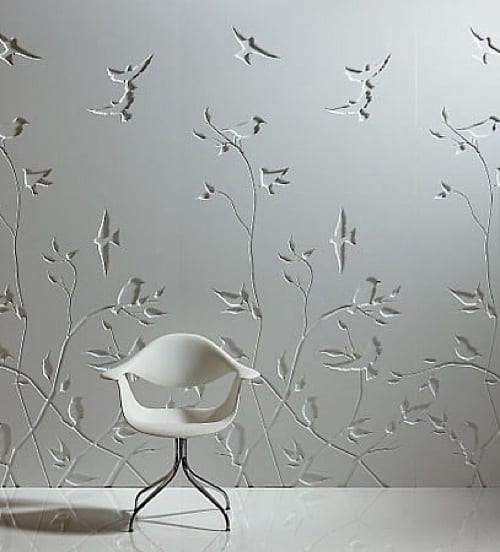 engraved wall panels with flowers and birds