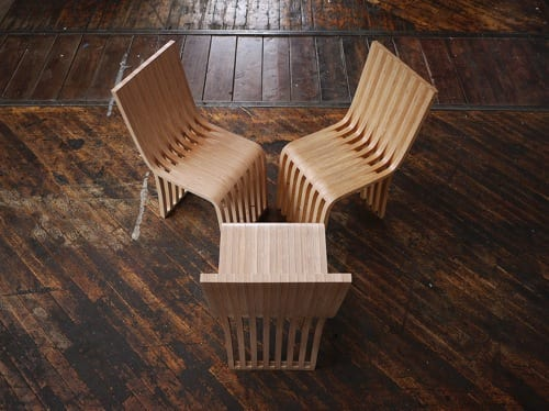 wavy wooden dining chairs