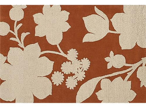brown and cream area rug