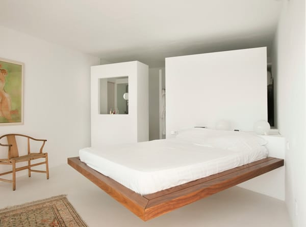 Modern bedroom furniture. Platform Bed in wood with white background.