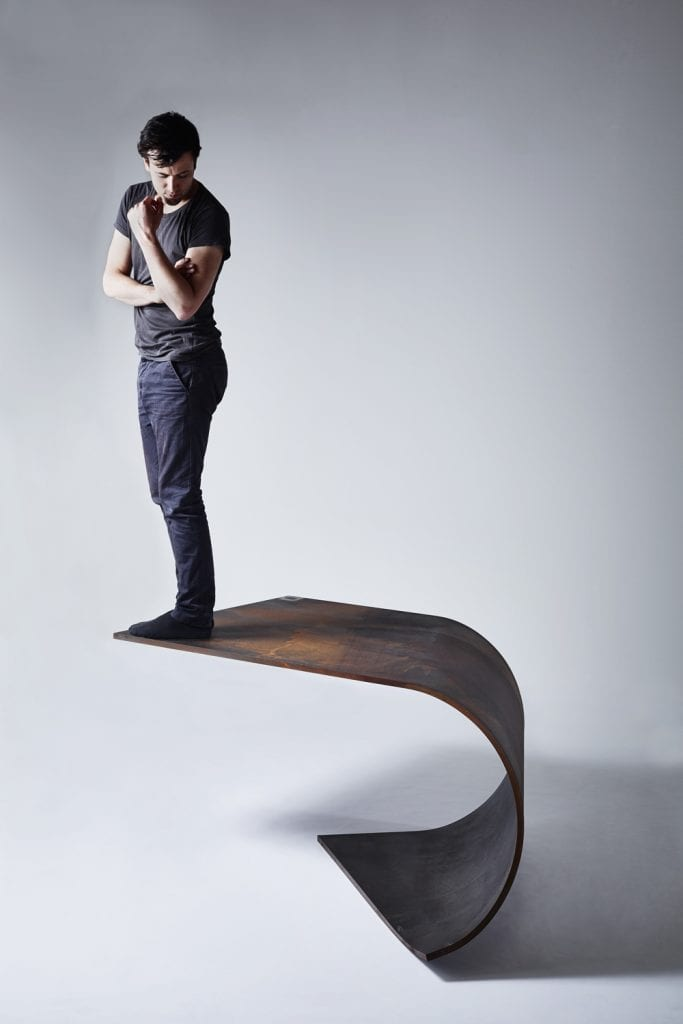 A Balanced Sheet of Steel: The Poised Table