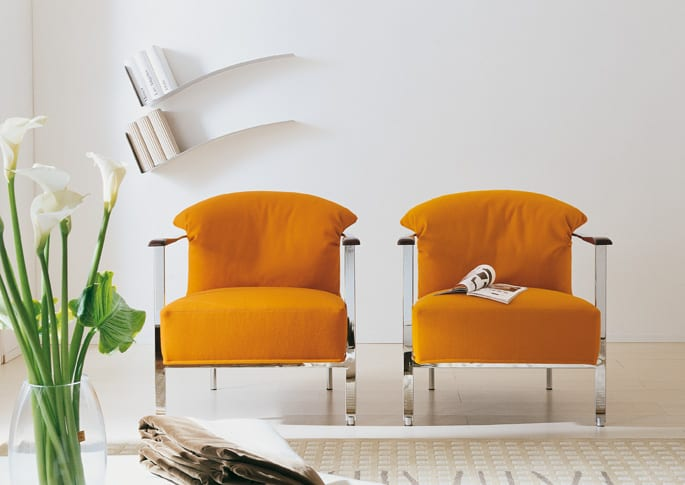 modern armchair with feather back pillow