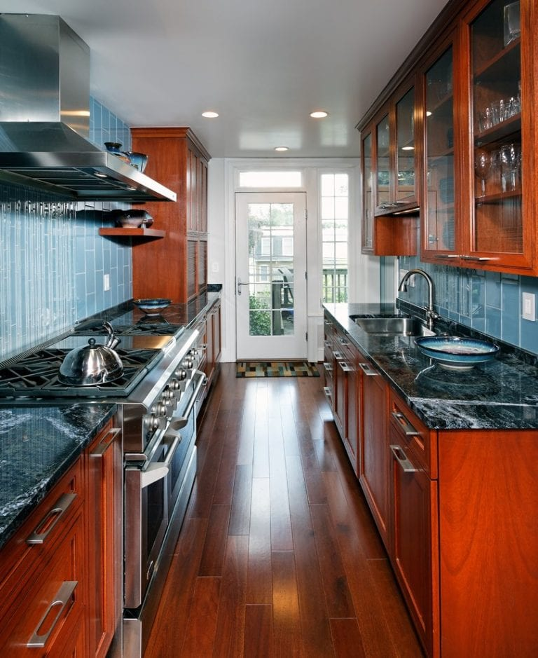 narrow kitchen design with cherry cabinets