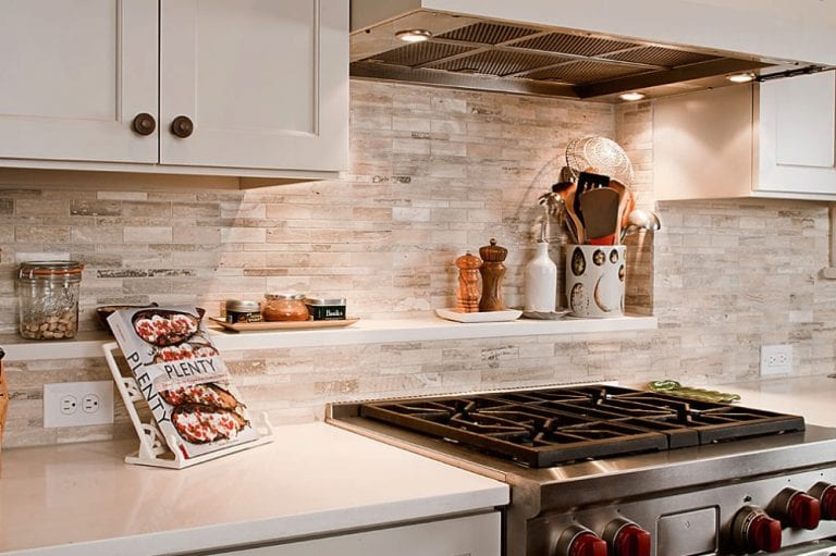 decorative kitchen featuring backsplash and stove top
