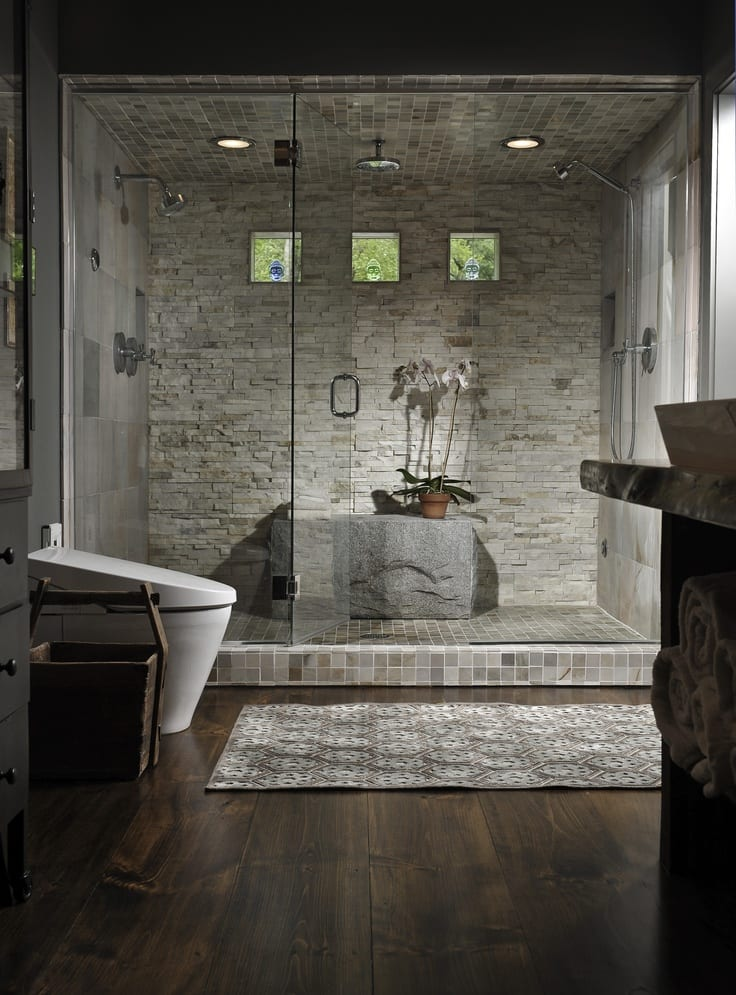 Beautiful natural looking shower stall with stone seat