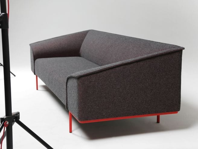 sofa with red metal legs
