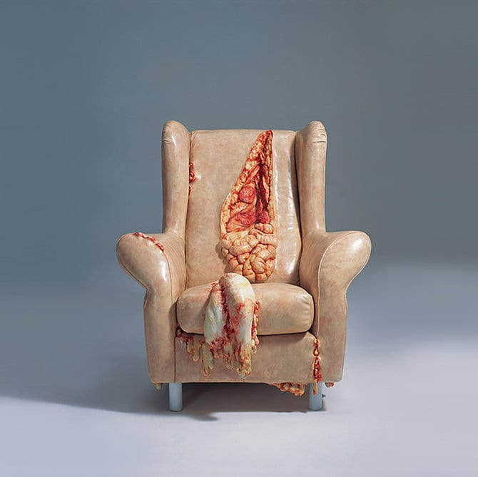 gruesome human parts armchair sculpture