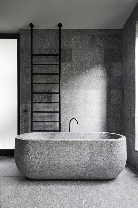 A rough looking concrete bathrub design in gray decor